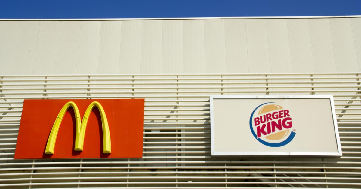 McDonald's & Burger King Signs on a Building